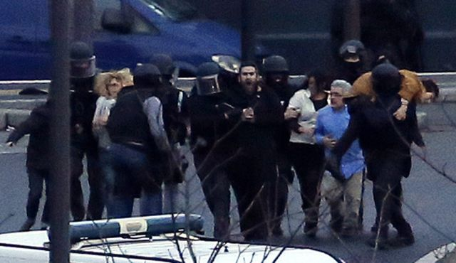 French police evacuate hostages after launching an assault at a kosher grocery store in eastern Paris, Jan. 9, 2015.Photo by AFP