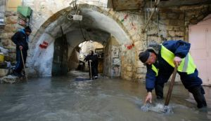 Flooding in Hebron, during last week's storms. Such distress, as well as power outages, compounds the PA's economic stagnation. Photo by Reuters