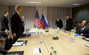 Thomson Reuters : US Secretary of State John Kerry takes his seat across the table from Russian Foreign Minister Sergey Lavrov.