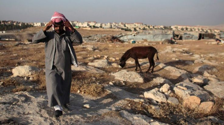 A Bedouin of the Jahalin tribe walks in his encampment near the Jewish settlement of Maale Adumim, east of Jerusalem, June 16, 2012.Reuters read more: http://www.haaretz.com/opinion/.premium-1.723737
